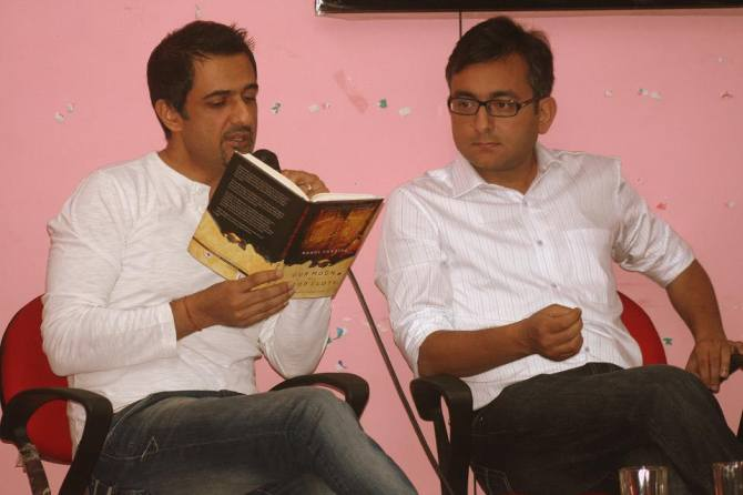 Rahul Pandita, right with actor Sanjay Suri at the launch of his book Our Moon Has Blood Clots.
