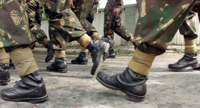 Soldiers of the 15 Corps march in Srinagar, June 14, 2002. The 15 Corps has been responsible for the defence of the Line of Control, dividing India and Pakistan in Kashmir since 1990.