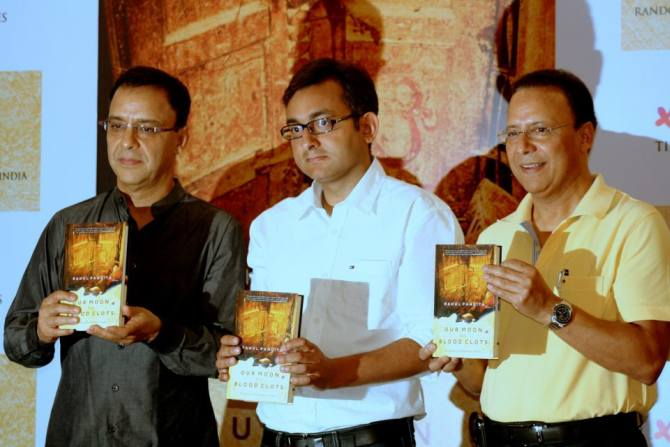 Rahul Pandita, centre, with filmmaker Vidhu Vinod Chopra, left, and his brother Vir Chopra at the launch of Our Moon Has Blood Clots.