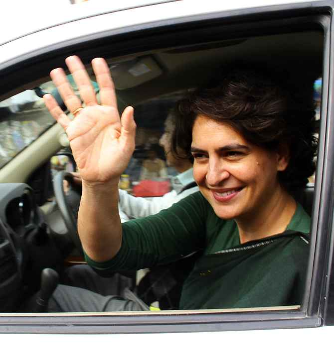 Priyanka Gandhi waves to her supporters after a meeting in Rae Bareli