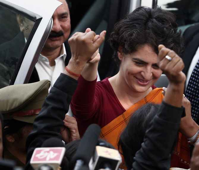 Priyanka Gandhi greets supporters after a meeting at Rae Bareli