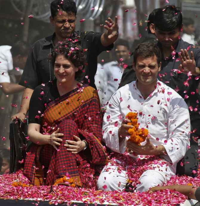 Supporters shower rose petals on Rahul and Priyanka Gandhi before Rahul filed his nomination papers from Amethi