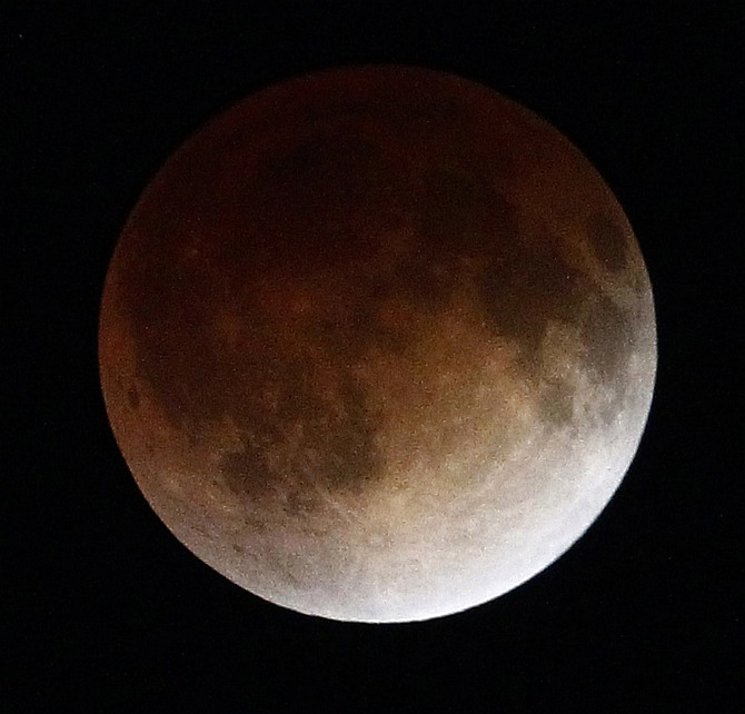 A shadow falls on the moon as it undergoes a total lunar eclipse as seen from Mexico City