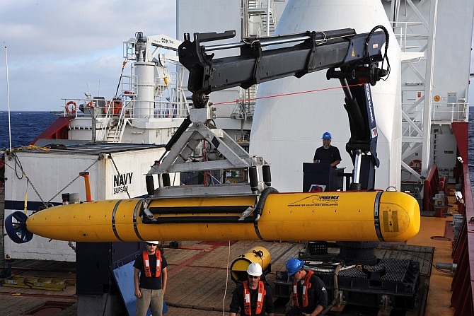 Crew aboard the Australian Defence Vessel Ocean Shield move the US Navy's Bluefin-21 autonomous underwater vehicle into position for deployment in the southern Indian Ocean to look for the missing Malaysia Airlines flight MH370