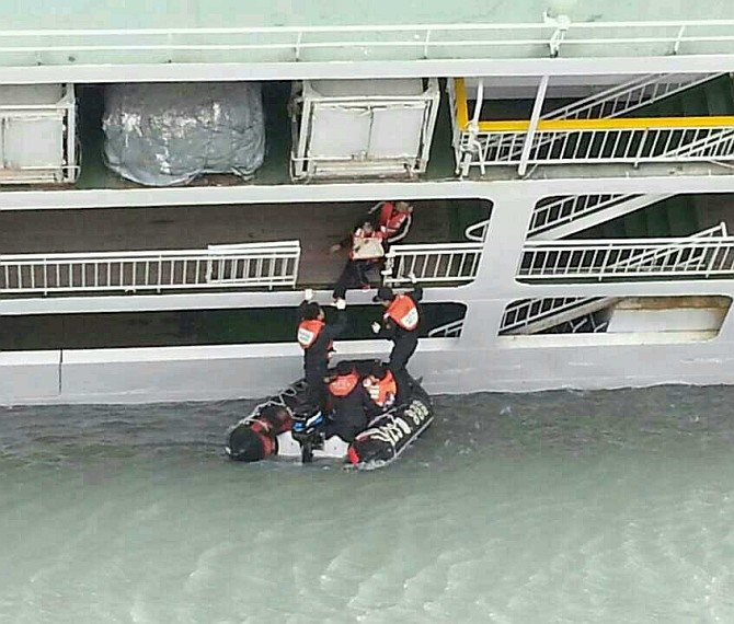 In this handout image provided by the Republic of Korea Coast Guard, passengers are rescued by the Republic of Korea Coast Guard from a ferry sinking off the coast of Jindo Island