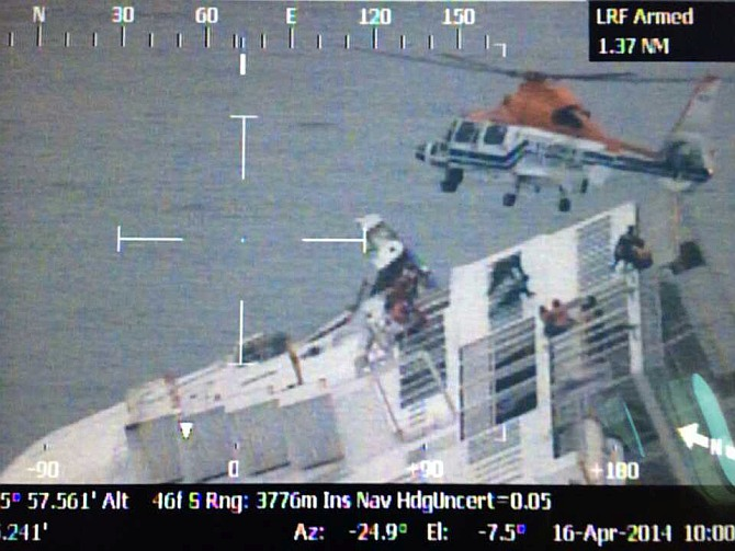 In this handout image provided by the Republic of Korea Coast Guard, rescue work by members of the Republic of Korea Coast Guard continues around the ferry sinking off the coast of Jindo Island