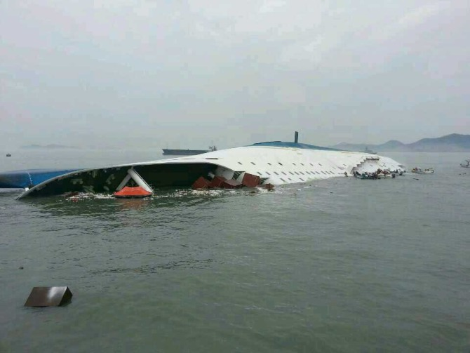 In this handout image provided by the Republic of Korea Coast Guard, a passenger ferry sinks off the coast of Jindo Islan