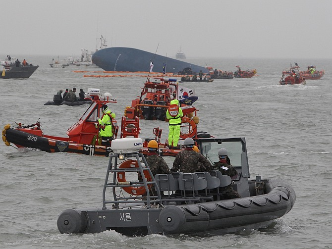 South Korean Coast Guard and rescue teams search for missing passengers at the site of the sunken ferry off the coast of Jindo Island