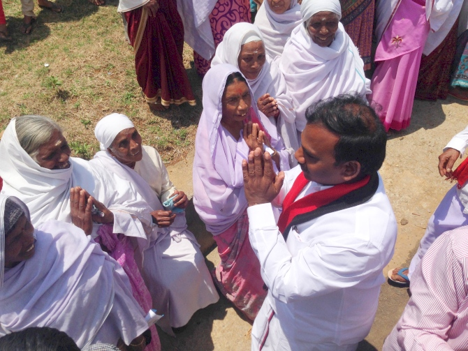 A Raja greets some of his constituents. Women showed up in strength on his campaign trail, offering aarti, performing the poorna kumbh, applying tilak on his forehead...