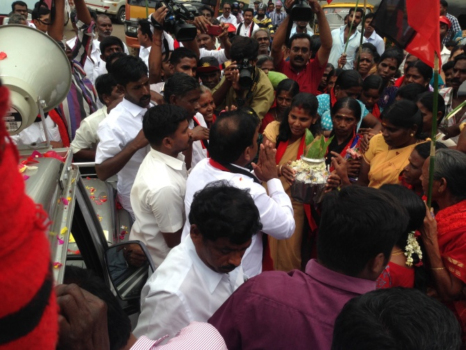 A Raja being offered aarti at a halt during his campaign.