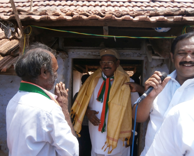 J M Haroon Rashid, the Congress candidate from Theni district, southern Tamil Nadu is greeted by supporters.
