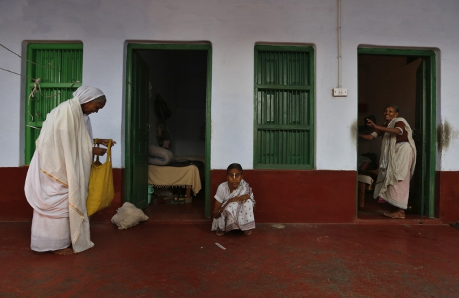 Widows stand outside their rooms at the Meera Sahavagini ashram in Vrindavan, Uttar Pradesh.