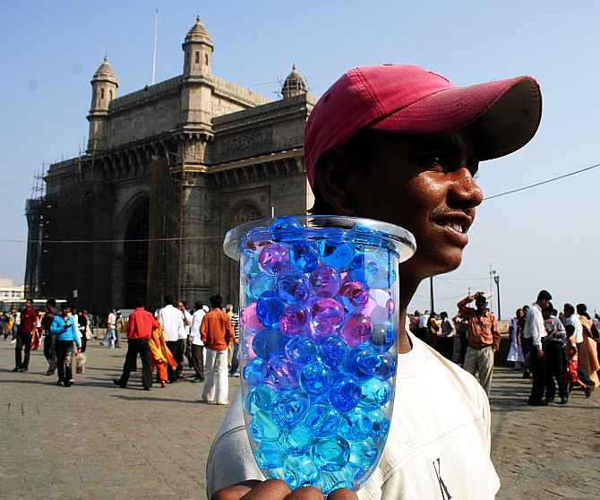 A vendor sells his wares at Gateway of India, a hot spot for tourists.
