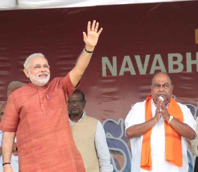 Narendra Modi greets supporters at a rally in Hyderabad.