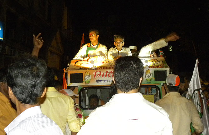 Milind Deora, the Congress candidate for Mumbai South, campaigning at night through Mumbadevi, with local MLA Amin Patel.