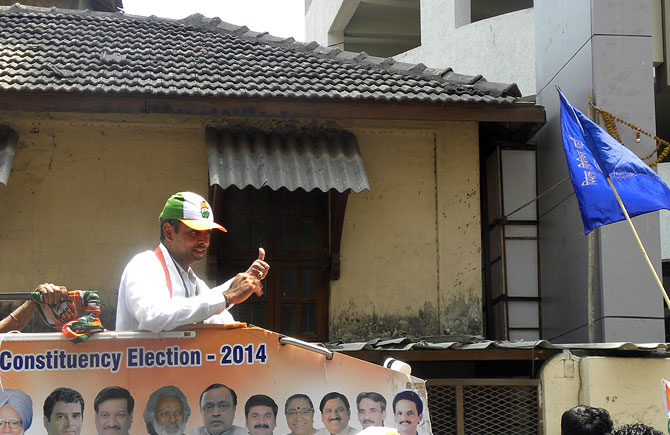 Candidate Deora flashes the thumbs up sign in Byculla.