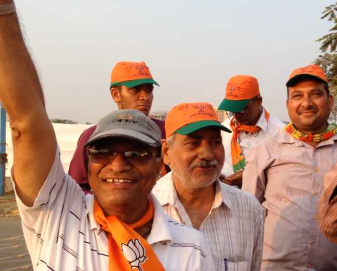 Supporters of Narendra Modi cheer for their leader ahead of his rally on Monday