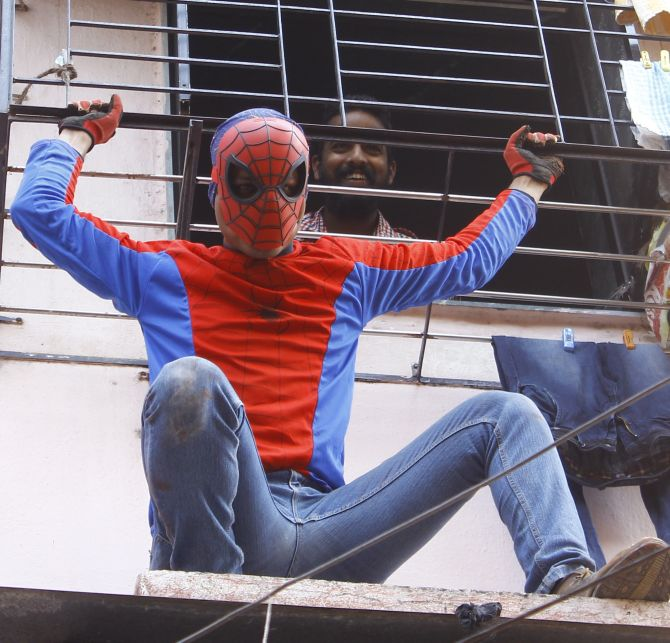 Indian Spider-Man Gaurav Sharma poses for a photograph during election campaigning in Girgaum, Mumbai.