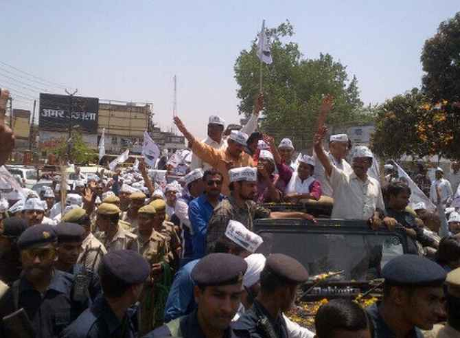 Kejriwal greets supporters during a road show in Varanasi on Wednesday