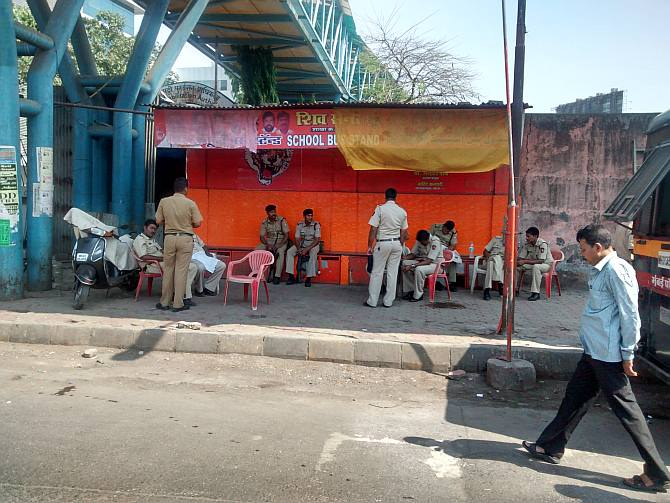Constables and officers belonging to Mumbai Police, State Reserve Police Force and Central Paramilitary Force take rest under the Bandra East footover bridge in an area sponsored by the local unit of the Shiv Sena