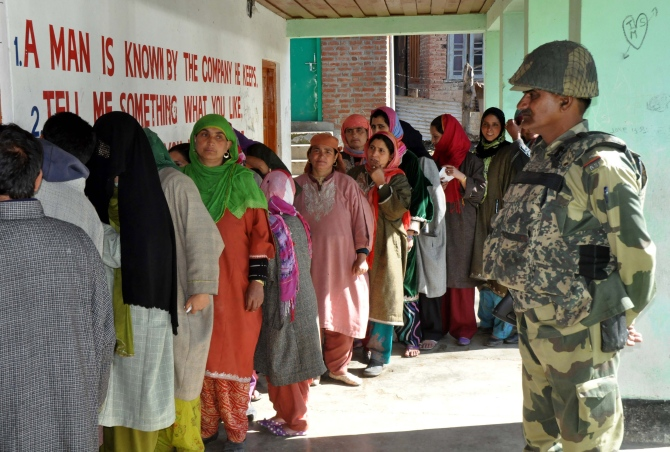 Women queue up to cast their votes in Srinagar