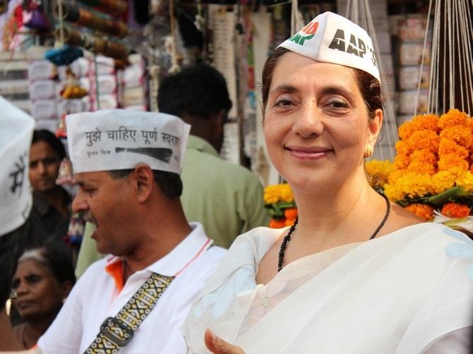 AAP's Meera Sanyal, pauses while campaigning at Colaba market, in Mumbai South