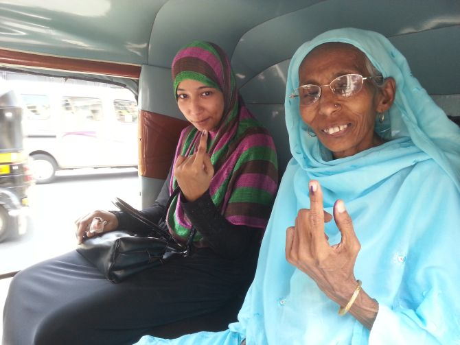 Tazeen and her mother leave the polling station after casting their vote.