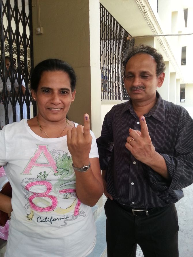 Lina Menezes and Lancy D'Souza flaunt their finger after voting.