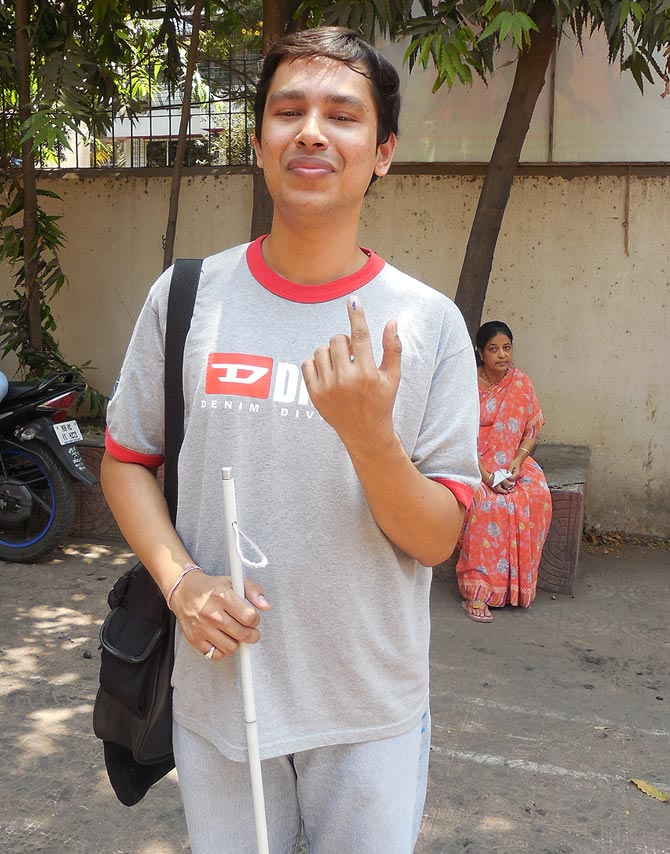 A visually impaired Divesh Sharma outside the poll station after voting