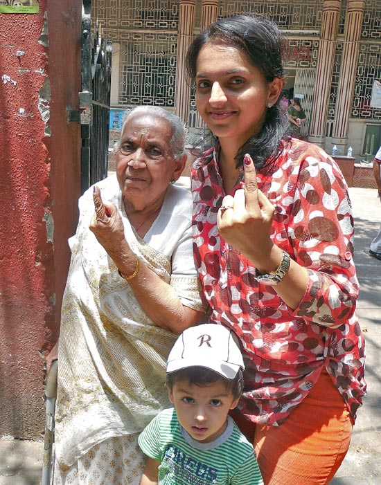 Dimple Kothari and her grandmother flaunt their fingers after voting