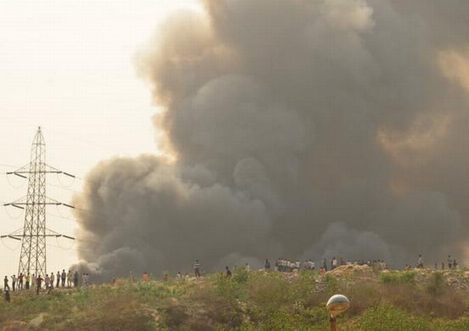 Smoke rises from the fire at Vasant Kunj, Delhi