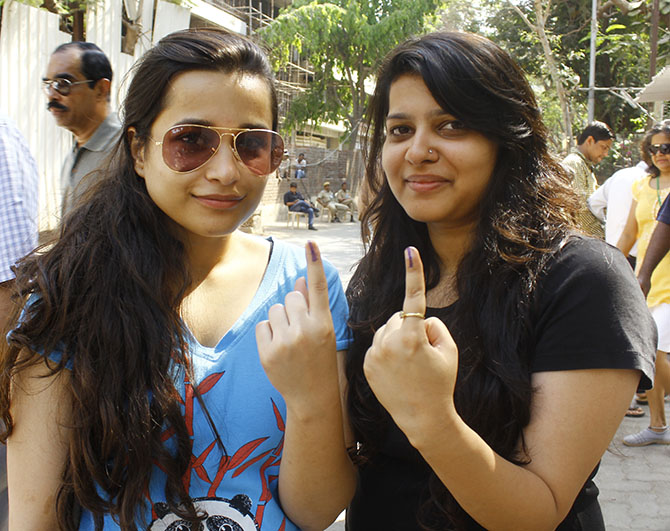 Youngsters pose after voting in Mumbai