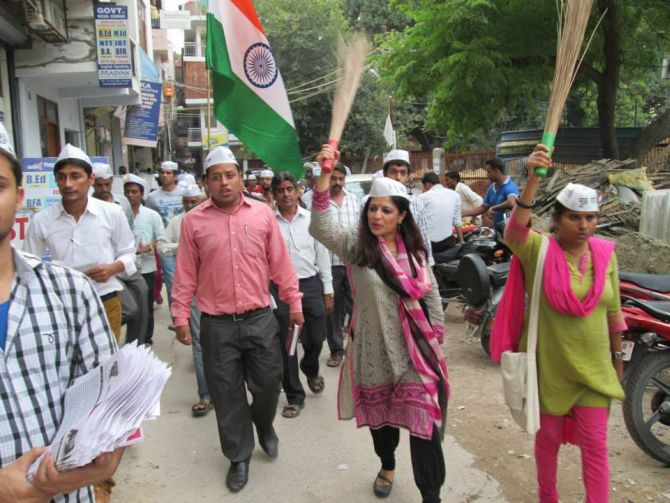 Carrying her party's symbol, the broom, Shazia on a campaign trail in Delhi.