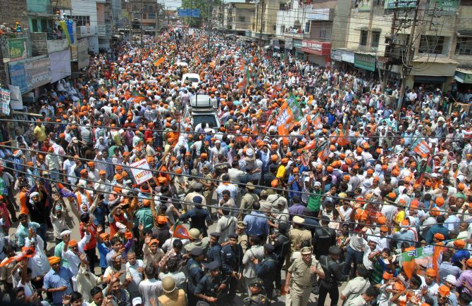 Narendra Modi's procession snakes through Varanasi as supporters try to catch a glimpse of their leader