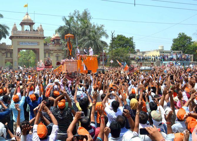 Modi pays floral tribute to Madan Mohan Malviya's statue in Varanasi.