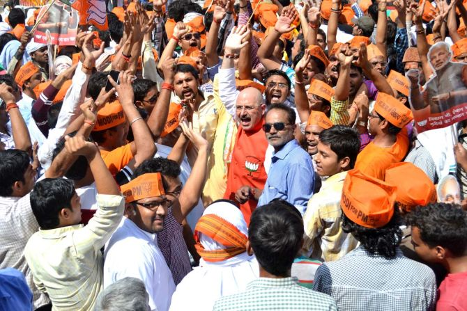 BJP supporters cheer for Modi in Varanasi.