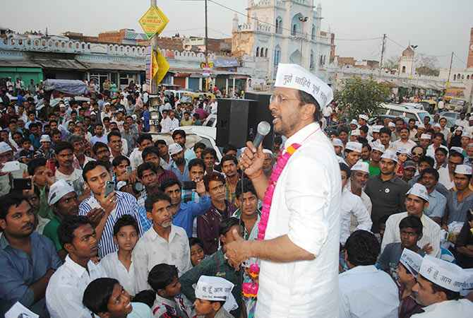 Javed Jafri addresses a road show in Lucknow.