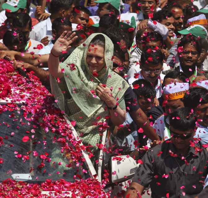 Sonia Gandhi waves to supporters as she arrives in Rae Bareli to file her nomination papers.