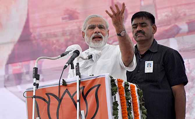 Narendra Modi addresses a campaign rally in Bhardoli.