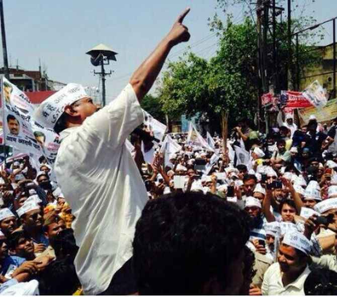 AAP leader Arvind Kejriwal addresses a road show in Varanasi.