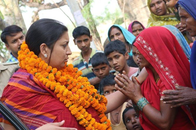 Smriti Irani speaks to a resident of Shukla Bazar during her campaign trail.