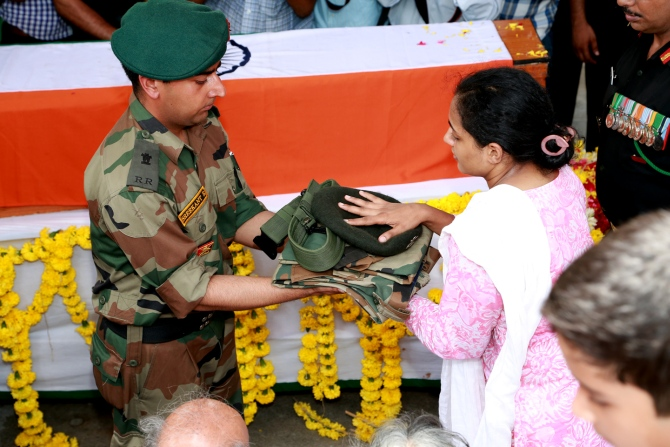 The major's wife Indhu Rebecca Varghese, receives his uniform.