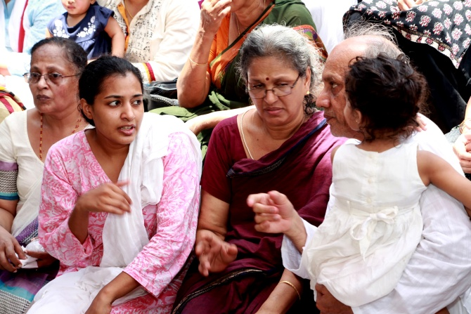 The bereaved family -- father R Vardarajan,mother Geetha, and wife Indhu Rebecca Varghese