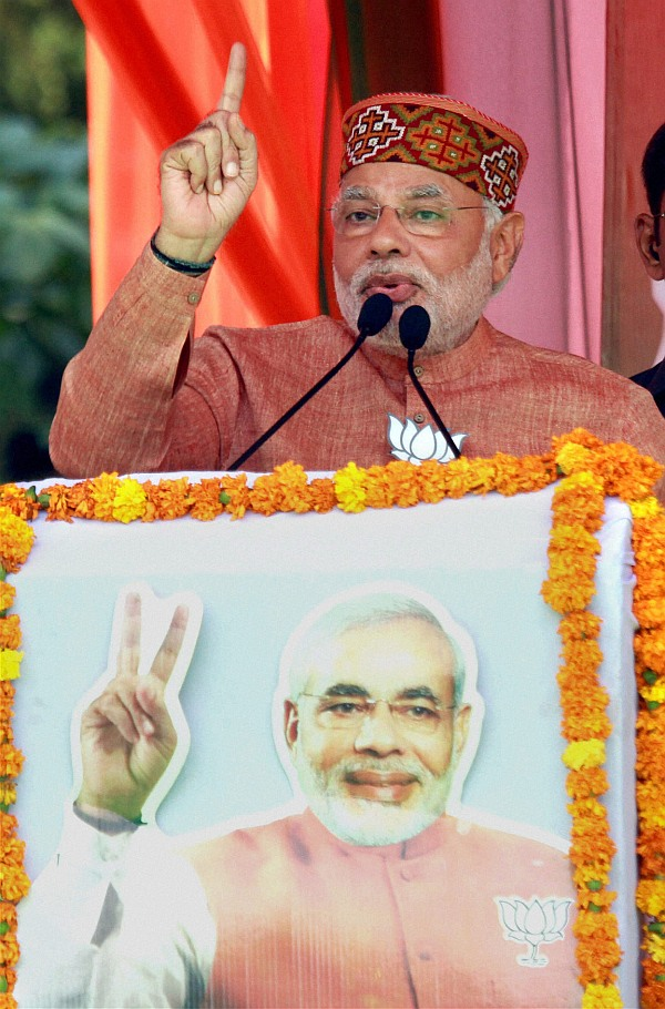 BJP PM candidate Narendra Modi addresses an election rally in Palampur, Himachal Pradesh o