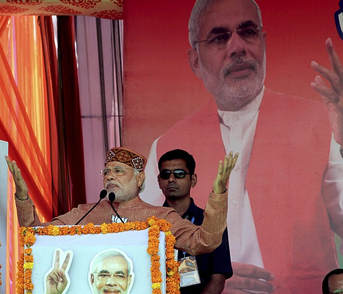 BJP PM candidate Narendra Modi addresses an election rally in Palampur, Himachal Pradesh on Tuesday.
