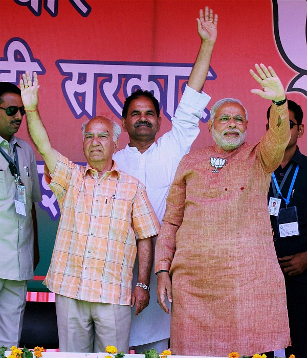 BJP PM candidate Narendra Modi with party candidate from Kangra Shanta Kumar during an election rally in Palampur, Himachal Pradesh on Tuesday