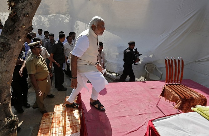Modi arrives to address his supporters in Ahmedabad