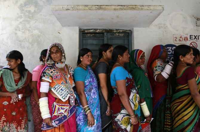 Voters line up to cast their votes outside a polling station in Rangareddy district in soon-to-be Telangana.