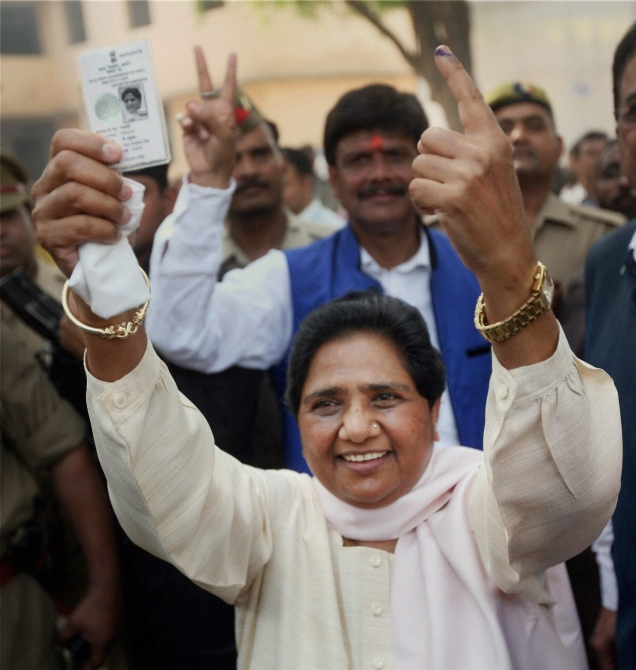 BSP supremo Mayawati shows her voter identity card and 'inked' finger after casting her vote in Lucknow.