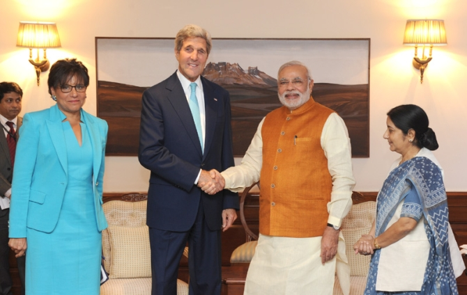 US Secretary of State John Kerry and US Secretary of Commerce Penny Pritzker calling on Prime Minister Narendra Modi, in New Delhi on August 01, 2014. The Union Minister for External Affairs and Overseas Indian Affairs Sushma Swaraj is also seen.